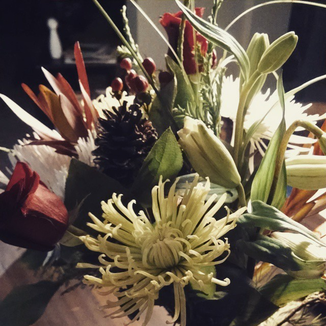 A vase full of pretty flowers make up for the $30 I spent on a damn ham #flowers #christmas #christmasparty